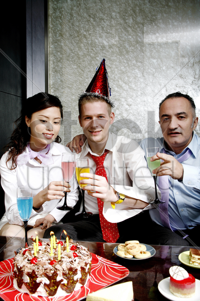 business people celebrating birthday stock photo