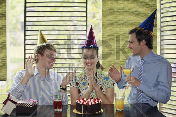 business people celebrating colleague's birthday stock photo