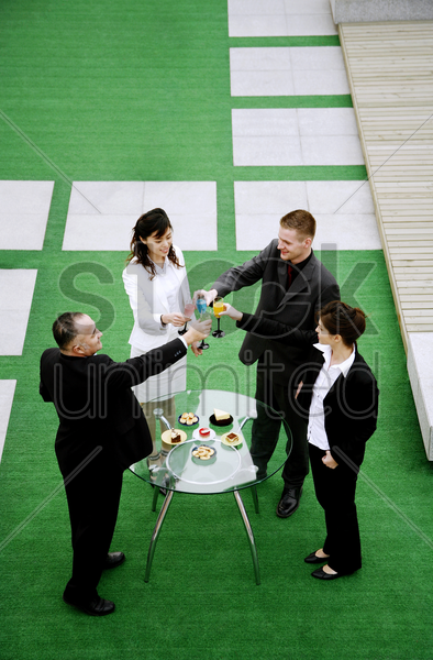 business people celebrating their achievement stock photo