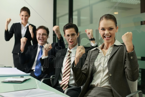 business people celebrating their success stock photo