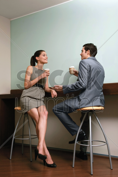 business people chatting and drinking coffee in the pantry stock photo
