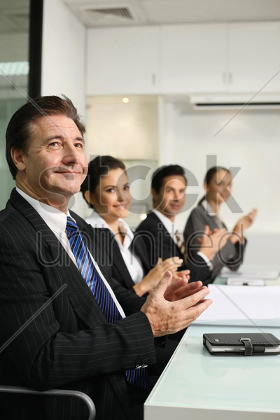 business people clapping hands at meeting stock photo