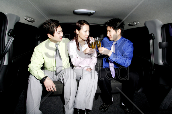 business people drinking wine in the car stock photo