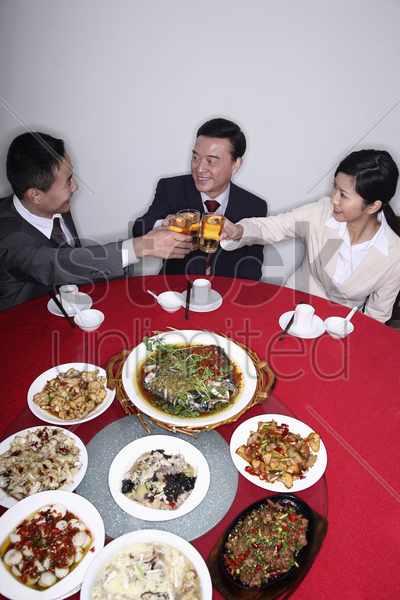 business people eating together stock photo