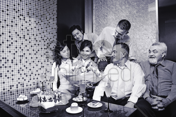 business people enjoying themselves in a birthday party stock photo