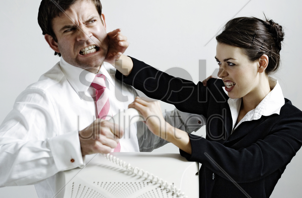 business people fighting over a phone call stock photo