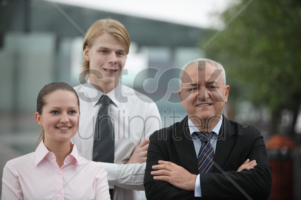 business people folding arms stock photo