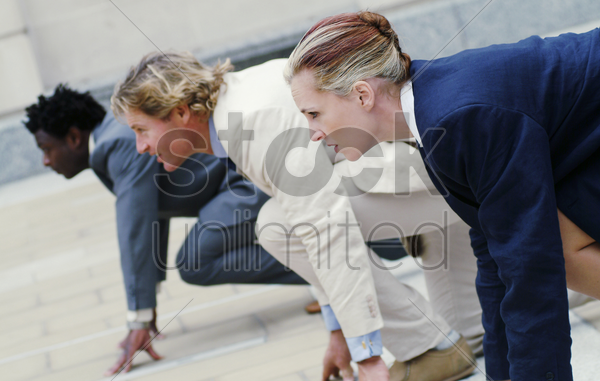 business people getting ready to run stock photo