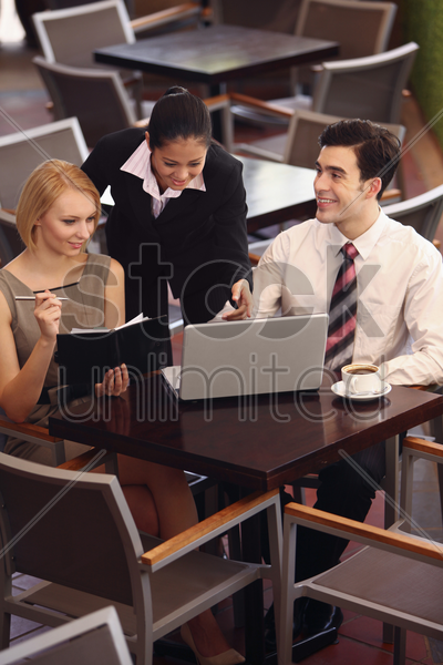 business people having discussion at a cafe stock photo