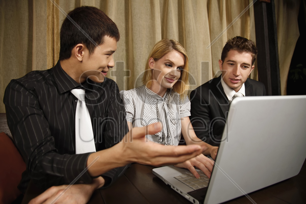 business people having discussion at a restaurant stock photo