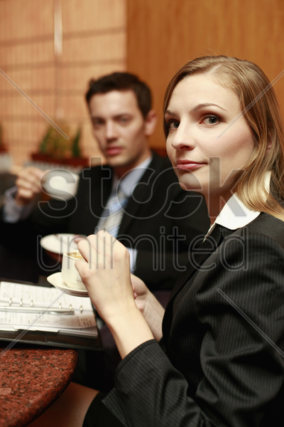 business people having discussion at cafe stock photo