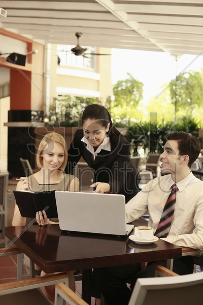 business people having discussion in a cafe stock photo