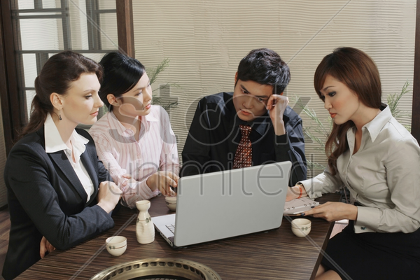 business people having discussion in a restaurant stock photo