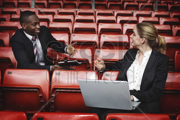 business people having discussion in a stadium stock photo