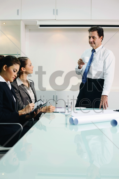 business people having discussion in conference room stock photo
