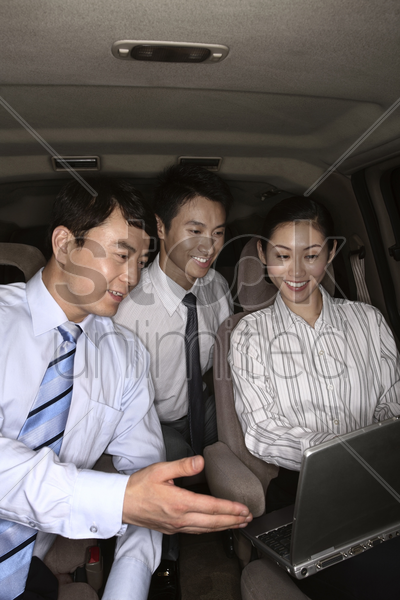business people having discussion in the car stock photo