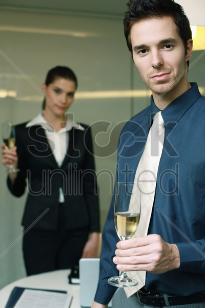business people holding glasses of champagne stock photo