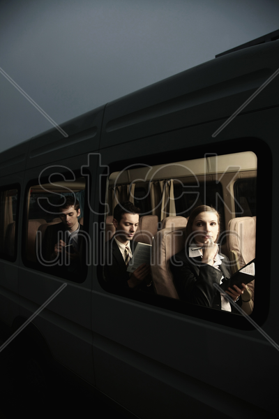 business people in a van stock photo