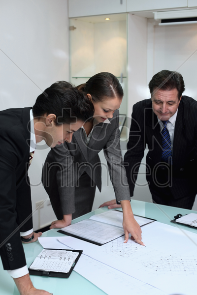 business people in discussion at conference table stock photo