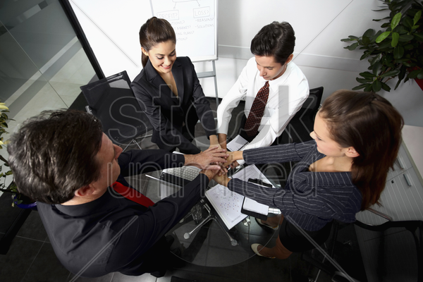 business people in huddle stock photo