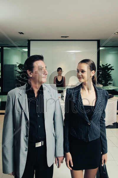 business people leaving the office stock photo