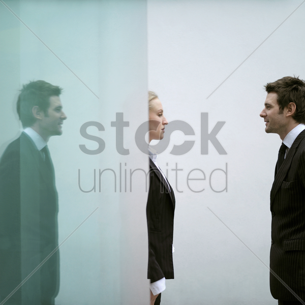 business people looking at each other stock photo