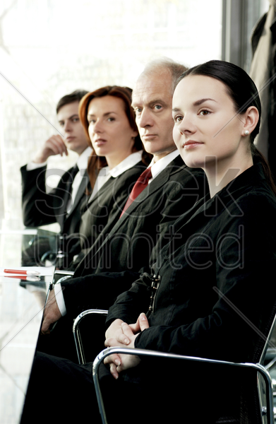 business people paying attention in the conference room stock photo