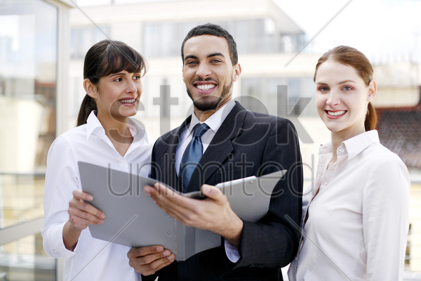 business people posing in a group stock photo