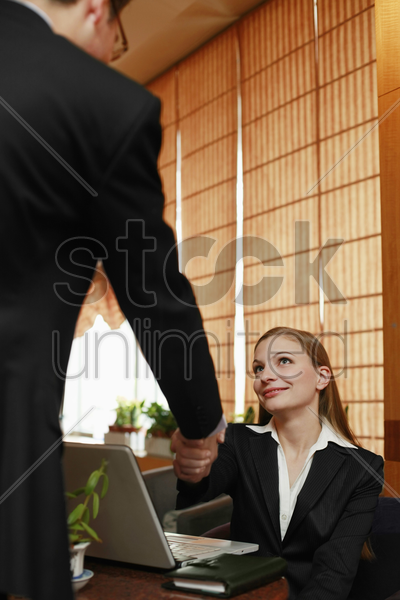 business people shaking hands in a cafe stock photo