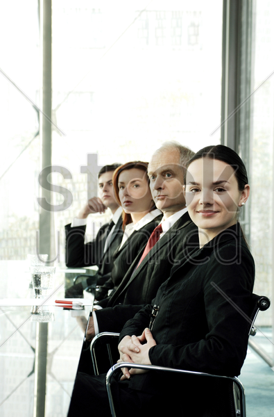 business people sitting in the conference room stock photo
