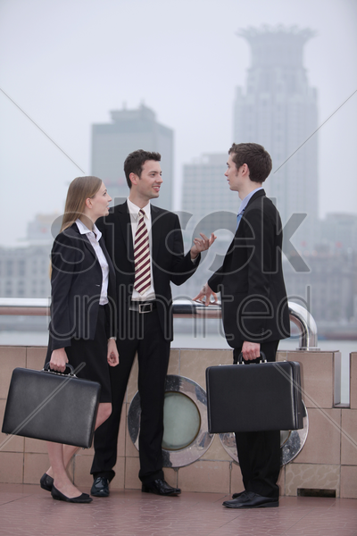 business people talking to each other outdoors stock photo