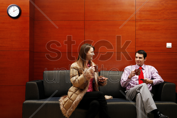 business people talking while drinking coffee stock photo