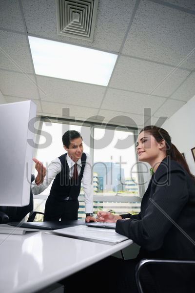 business people using computer at meeting stock photo