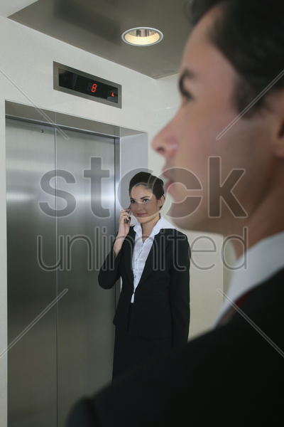 business people waiting for elevator stock photo