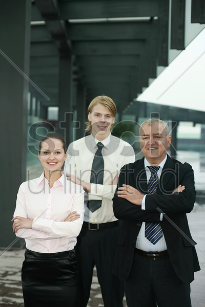 business people with their arms folded stock photo