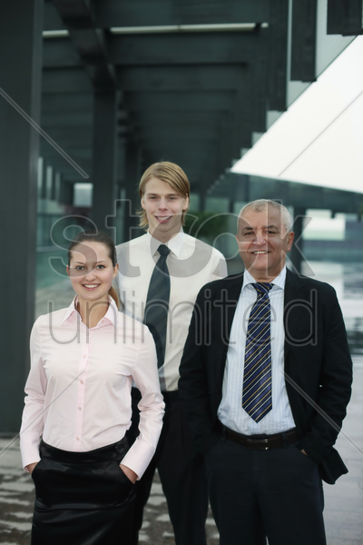 business people with their hands in the pockets stock photo