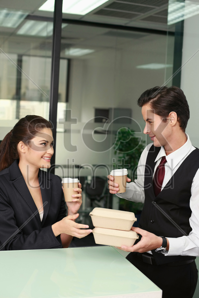 business people with their take-out food stock photo