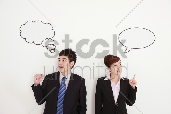 business people with thought and speech bubble above their heads stock photo