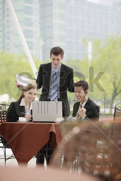 business people working together at outdoor cafe stock photo