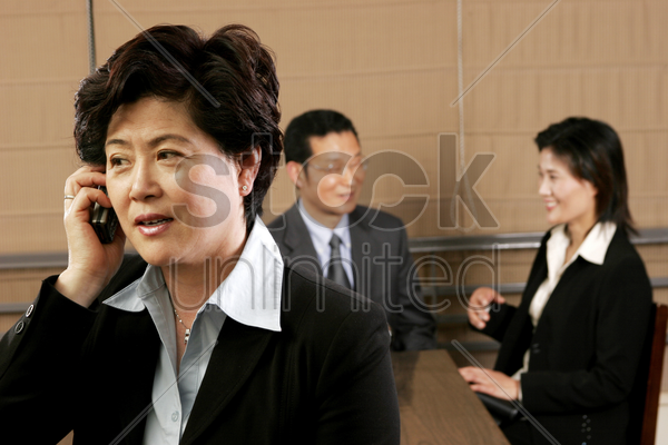 business woman talking on the hand phone stock photo