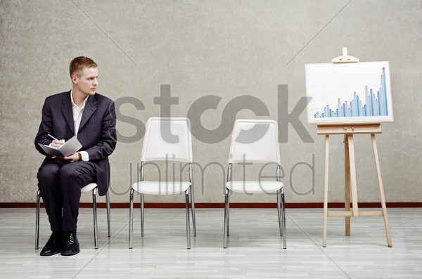 businessman analyzing a chart stock photo