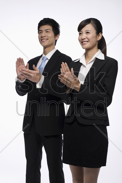 businessman and businesswoman clapping hands stock photo