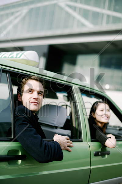 businessman and businesswoman in the taxi stock photo