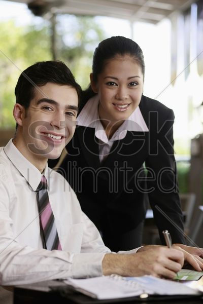businessman and businesswoman smiling stock photo