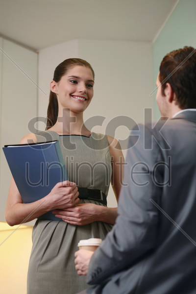 businessman and businesswoman talking stock photo