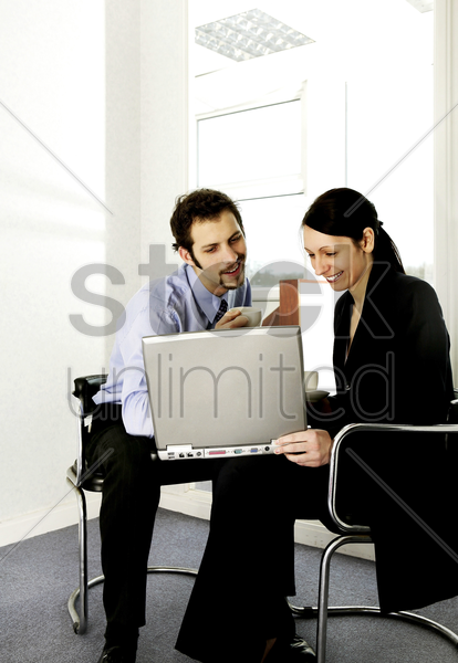 businessman and businesswoman working together stock photo