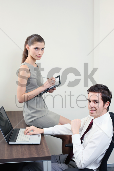 businessman and his assistant stock photo