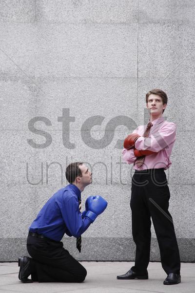 businessman begging his boss stock photo