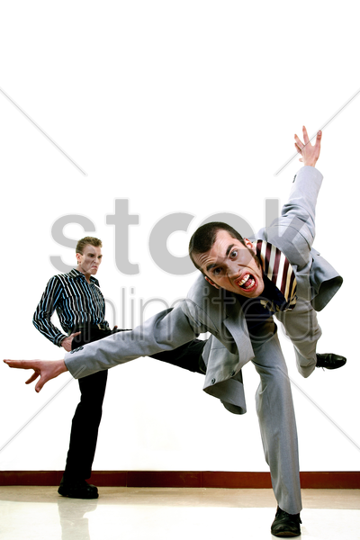 businessman being kicked out by his employer stock photo