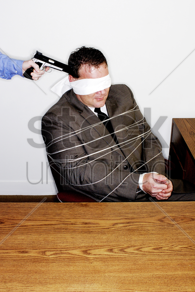 businessman being robbed stock photo